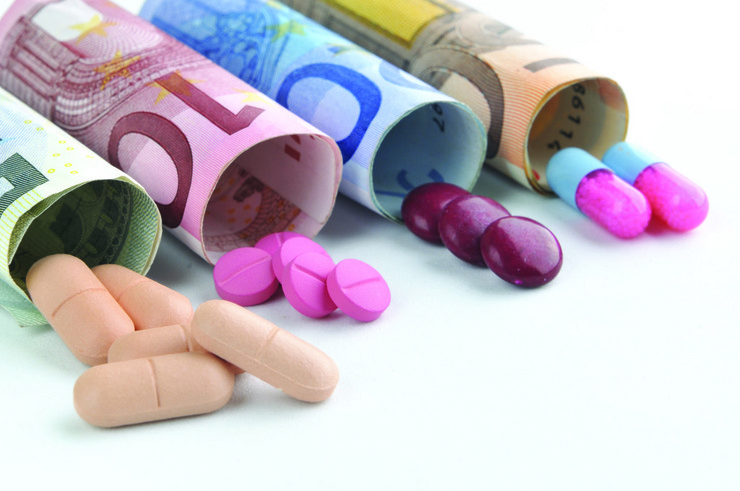 medical pills and tablets in euro bank notes money as a symbol o